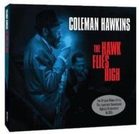 The hawk flies high